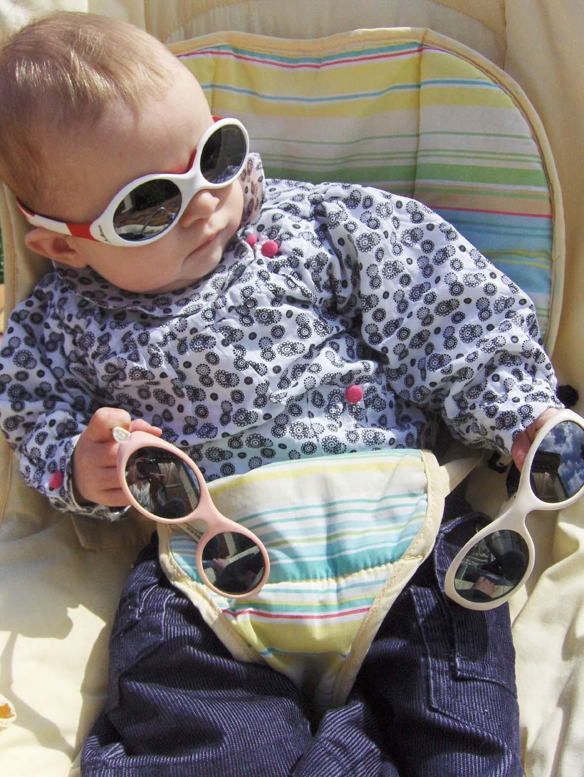 baby wearing sunglasses and holding shades