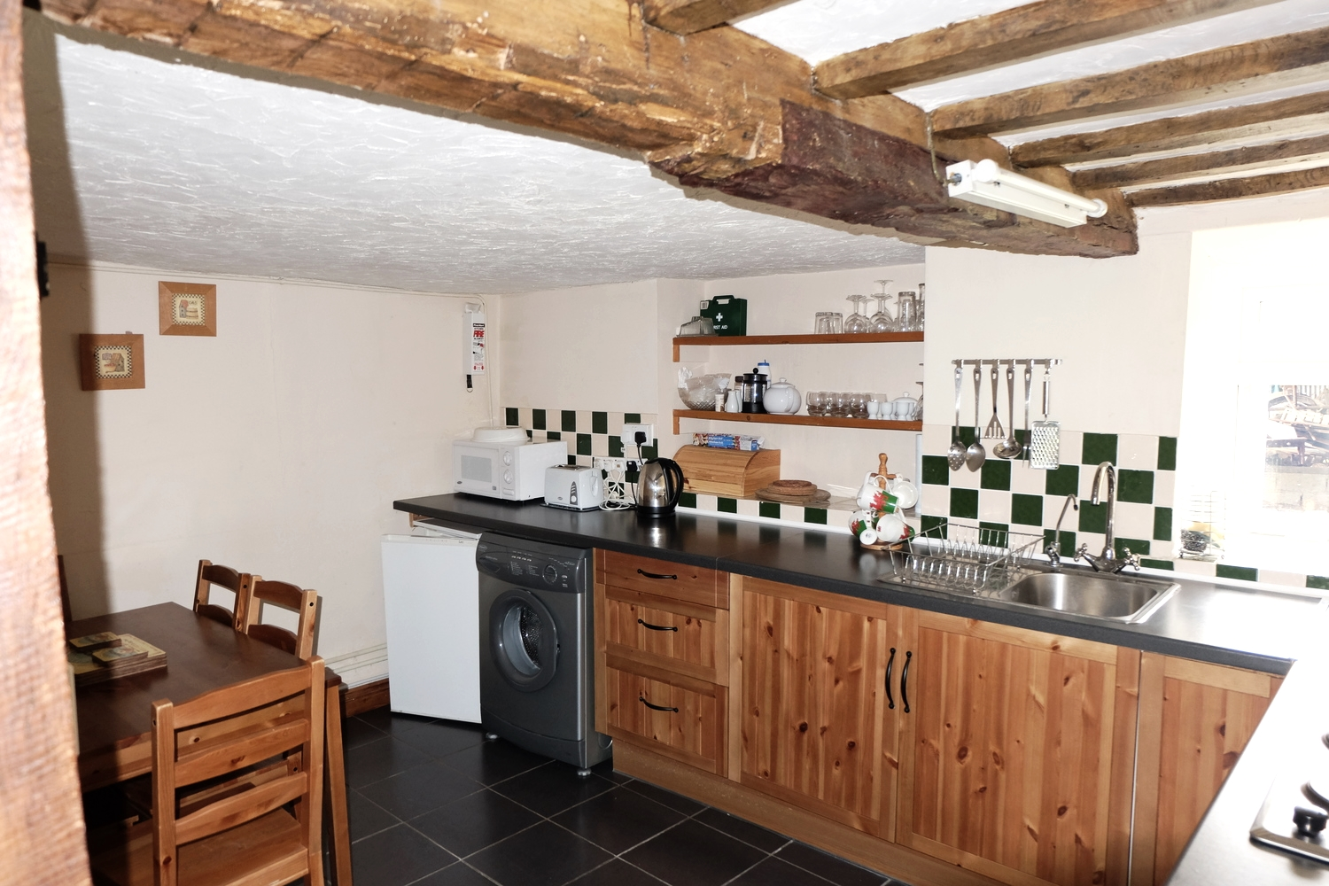 All main appliances are equipped within this spacious kitchen