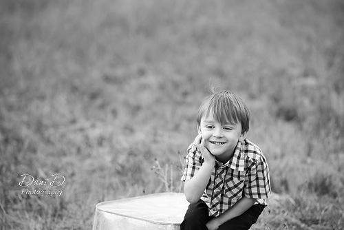 Boy sitting on a bucket in a field - - Redding CA Photographer - Dani D Photography