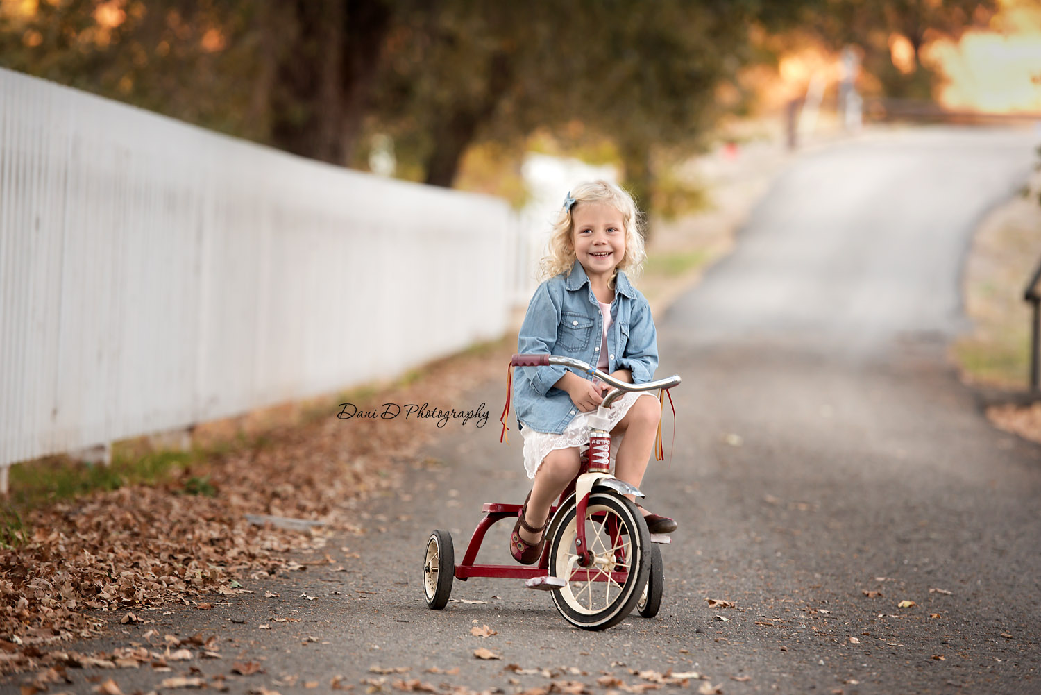 smiling girl on tricycle - Redding CA photographer - Dani D Photography