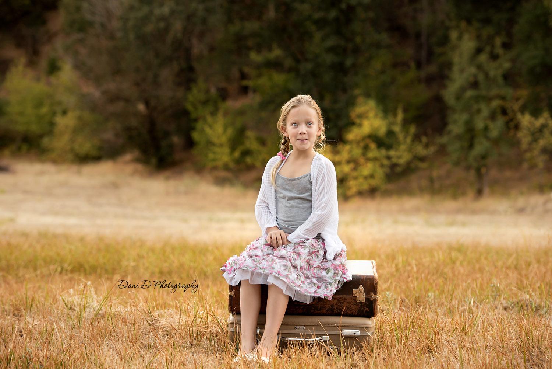 child's portrait in a field - Redding CA photographer - Dani D Photography