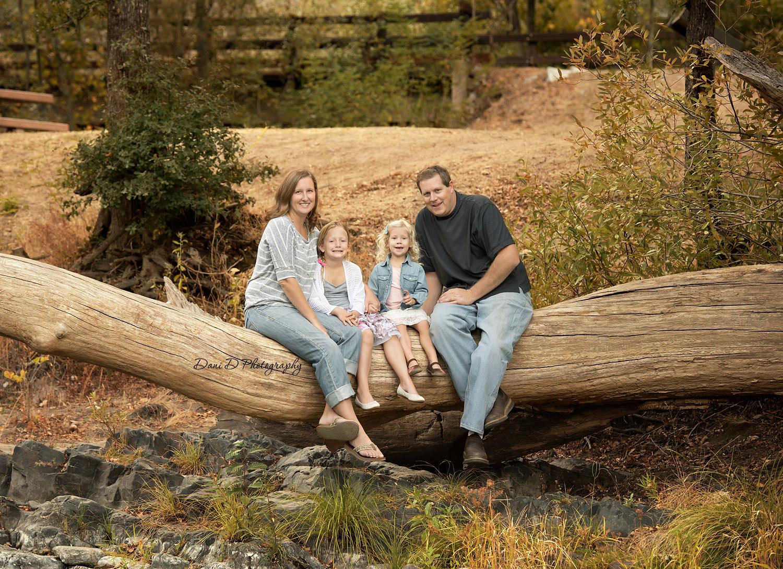 Family photo on a log - Redding CA photographer - Dani D Photography