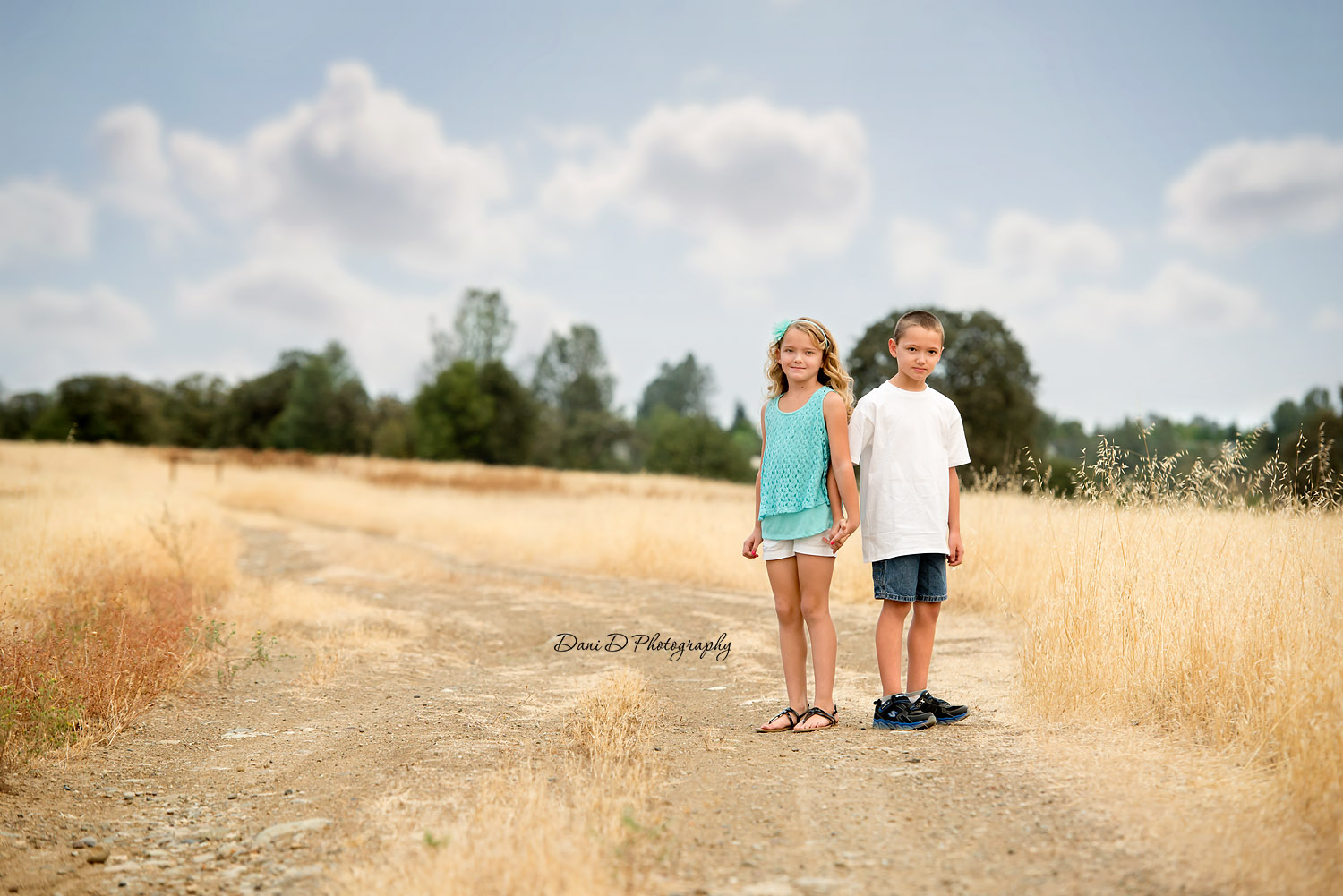 boy and girl twins in a field - Redding CA photographer - Dani D Photography