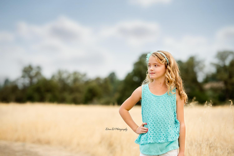 Child in field side profile portrait - Female child model in field - Redding CA photographer - Dani D Photography