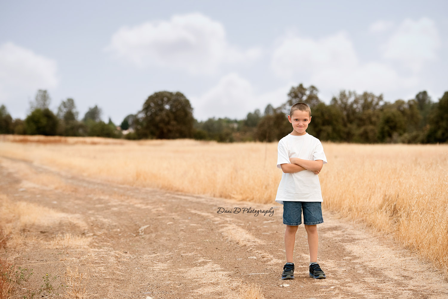Grumpy boy in field - Female child model in field - Redding CA photographer - Dani D Photography