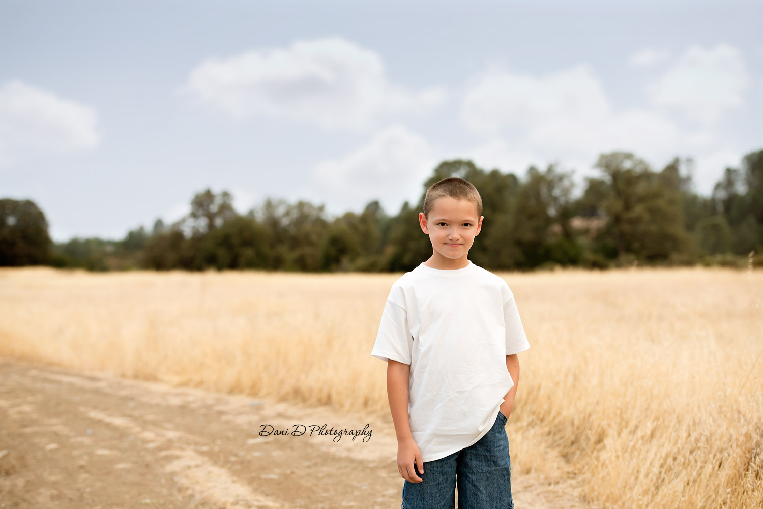 Portrait of a boy in a field - Female child model in field - Redding CA photographer - Dani D Photography