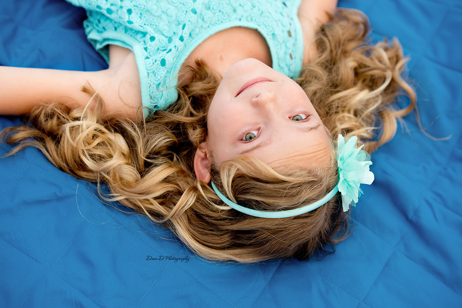 Photo of girl laying on a blanket outside - Redding CA photographer - Dani D Photography