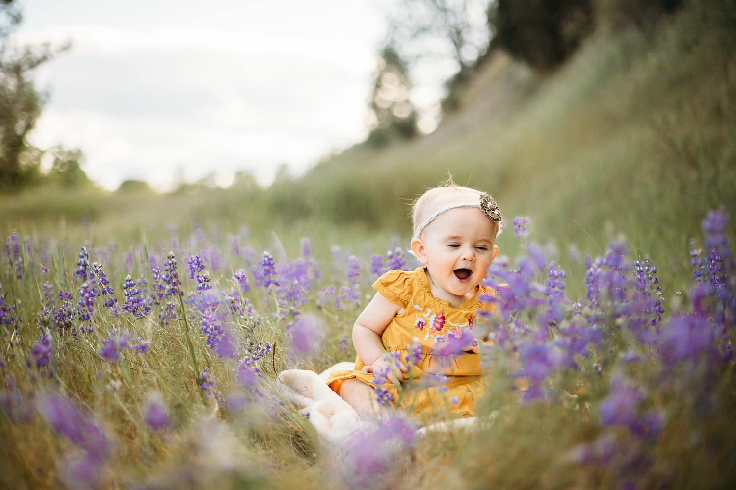 Toddler girl in a field of blue bonnets - Redding CA family photographer