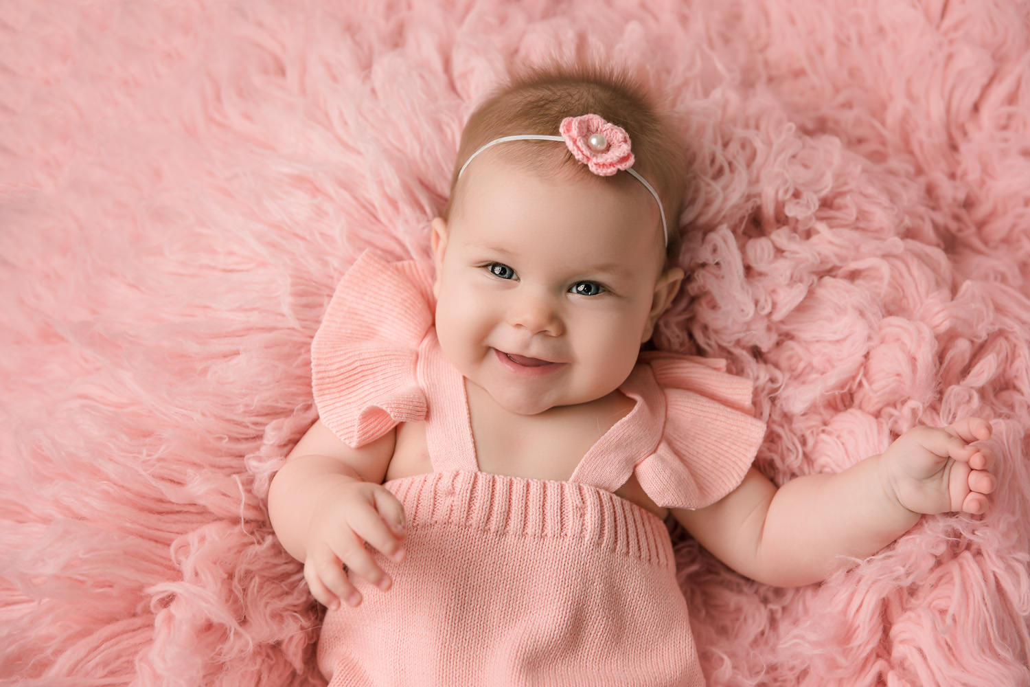 Baby girl on a pink fur rug - Redding, CA photo studios