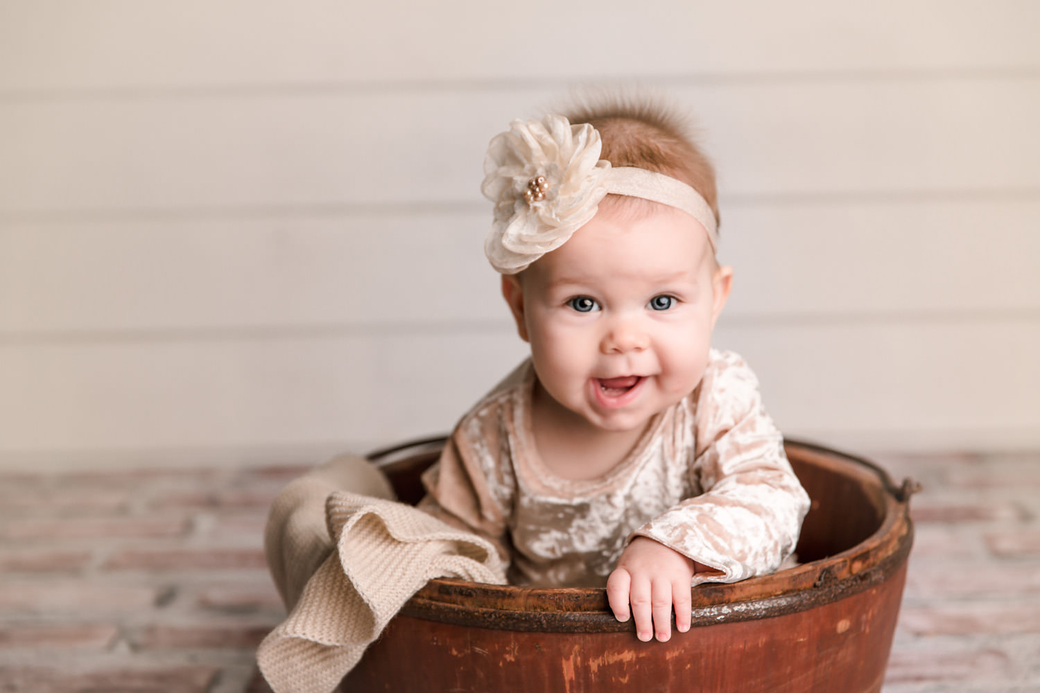 Smiling baby sitting in a bucket - Redding, CA Family photographers