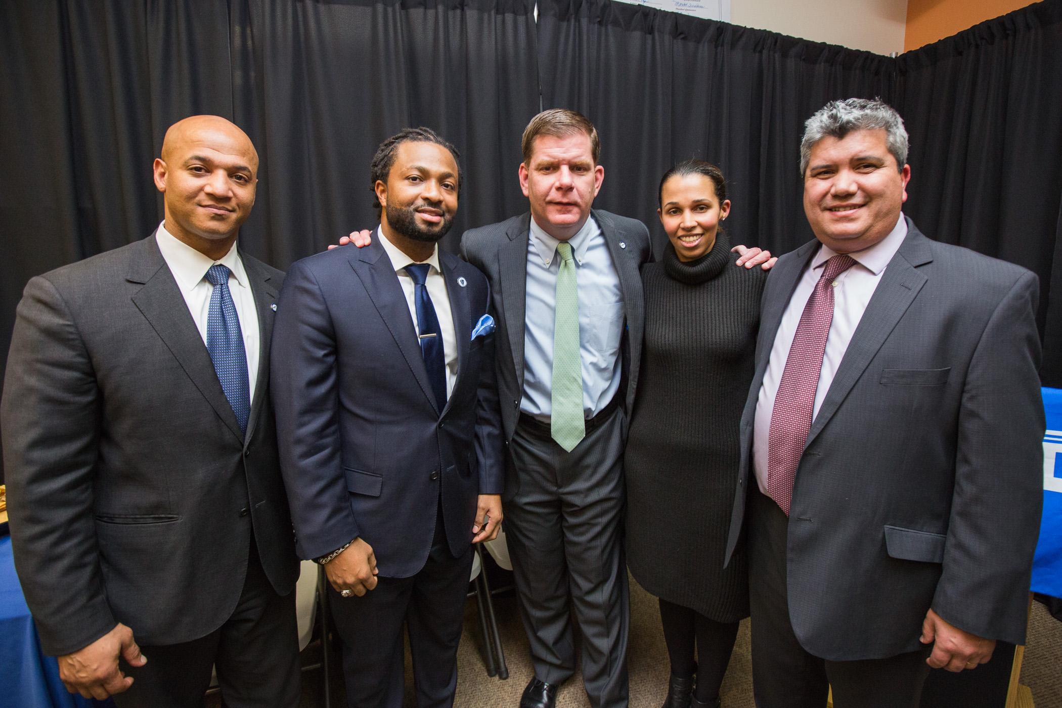 Left to right: John Barros, Boston's Chief of Economic Development; State Representative Evandro Carvalho; Mayor Marty Walsh; Keila Barros, DSNI's Board President; and Juan Leyton, DSNI's Executive Director.