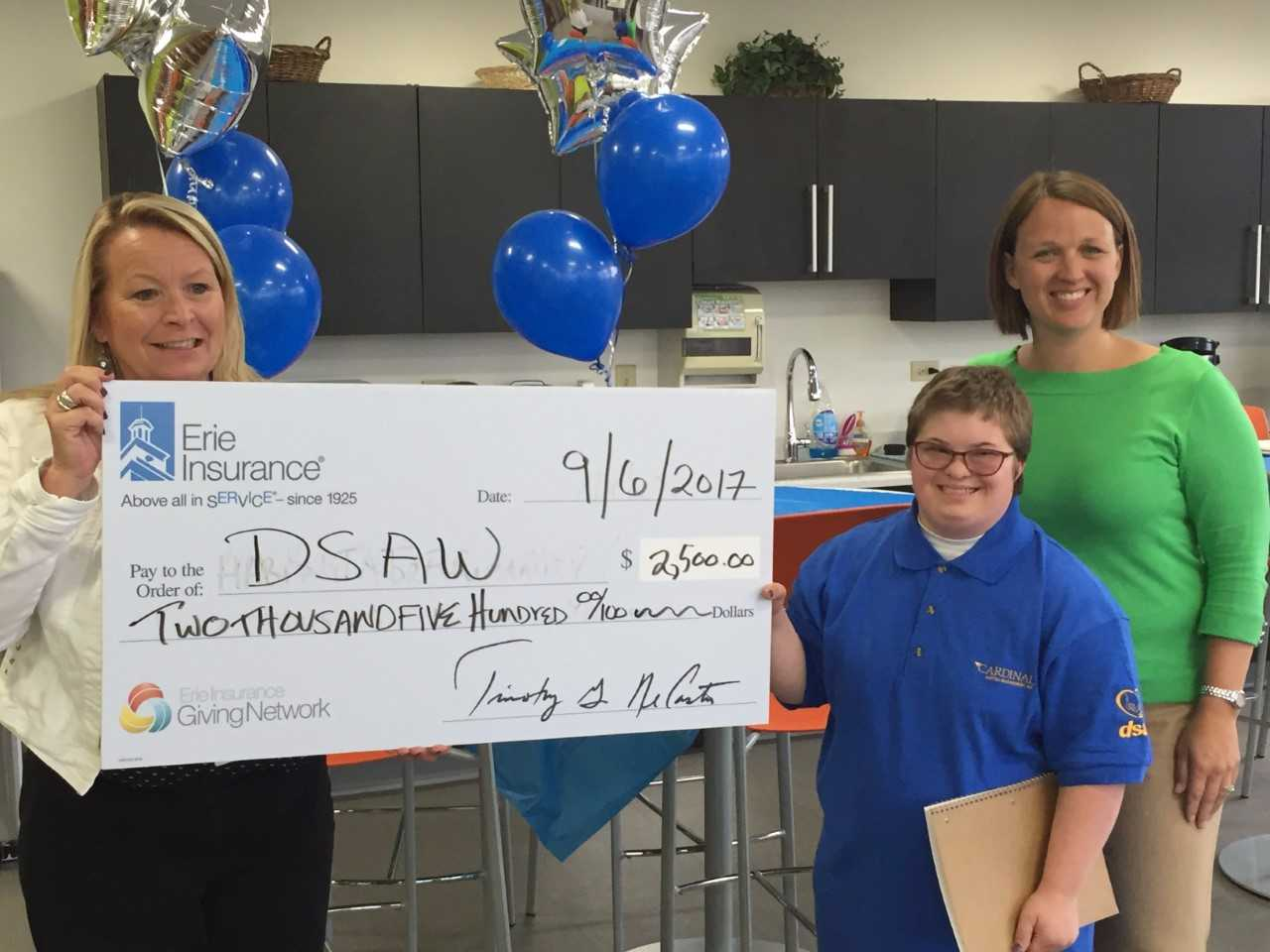 Self-advocate Michelle Levenhagen accepts a sponsorship from Erie Insurance for our Statewide Awareness Walk!