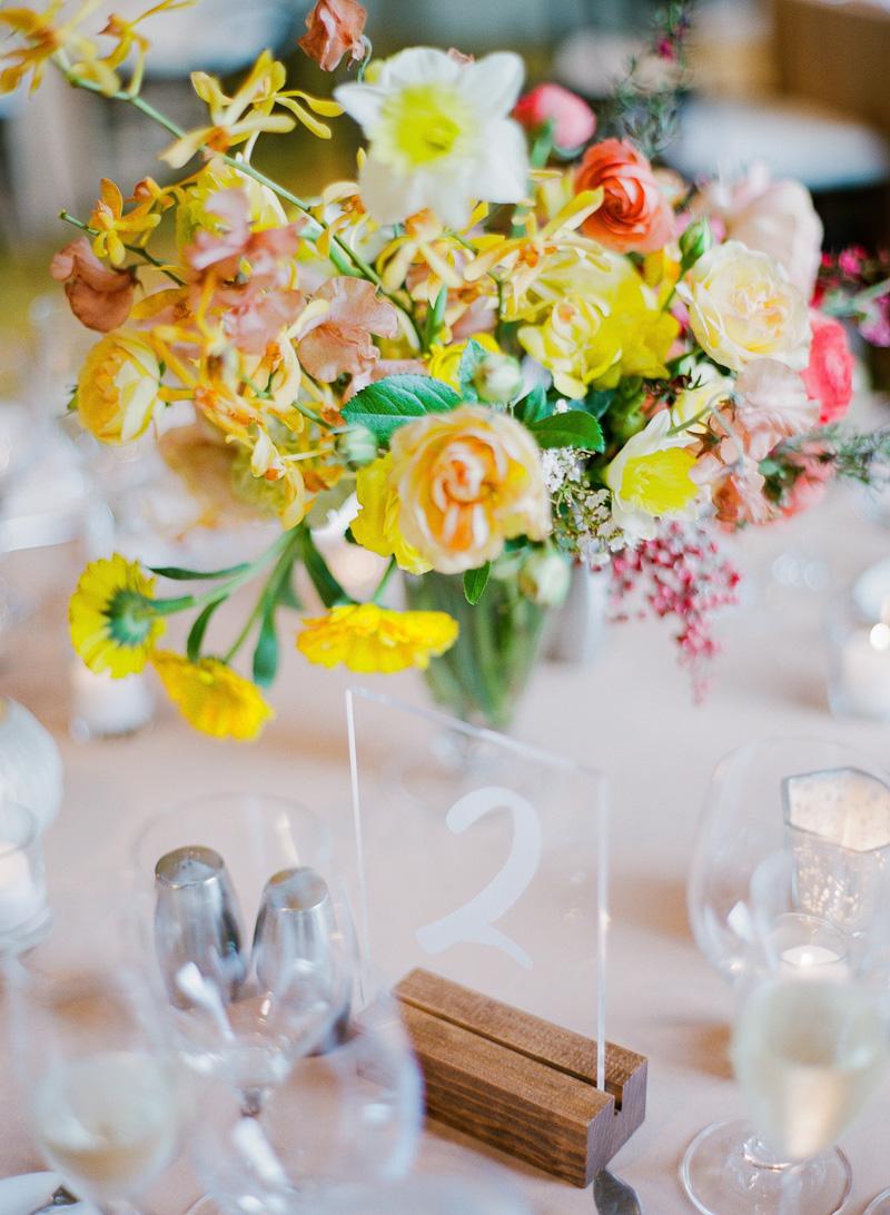 Photo by  Sorella Muse  / Florals by  Aqua Floral Design