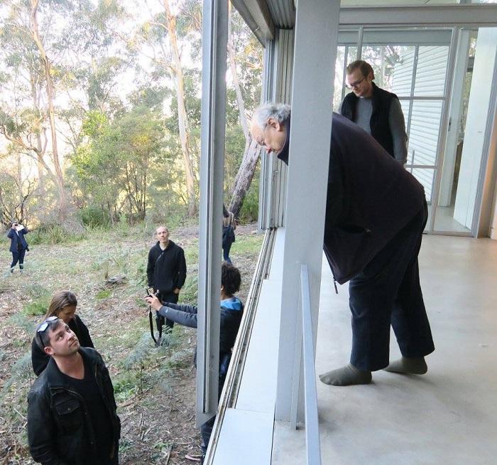 Glenn explaining the sliding door system at Simpson-Lee House (photo by Sophia van Greunen)