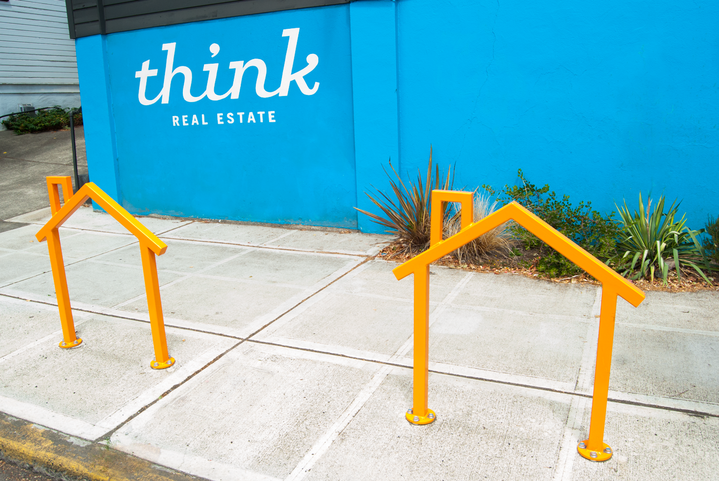 Part bike rack, part advertising for a great localreal estate company.