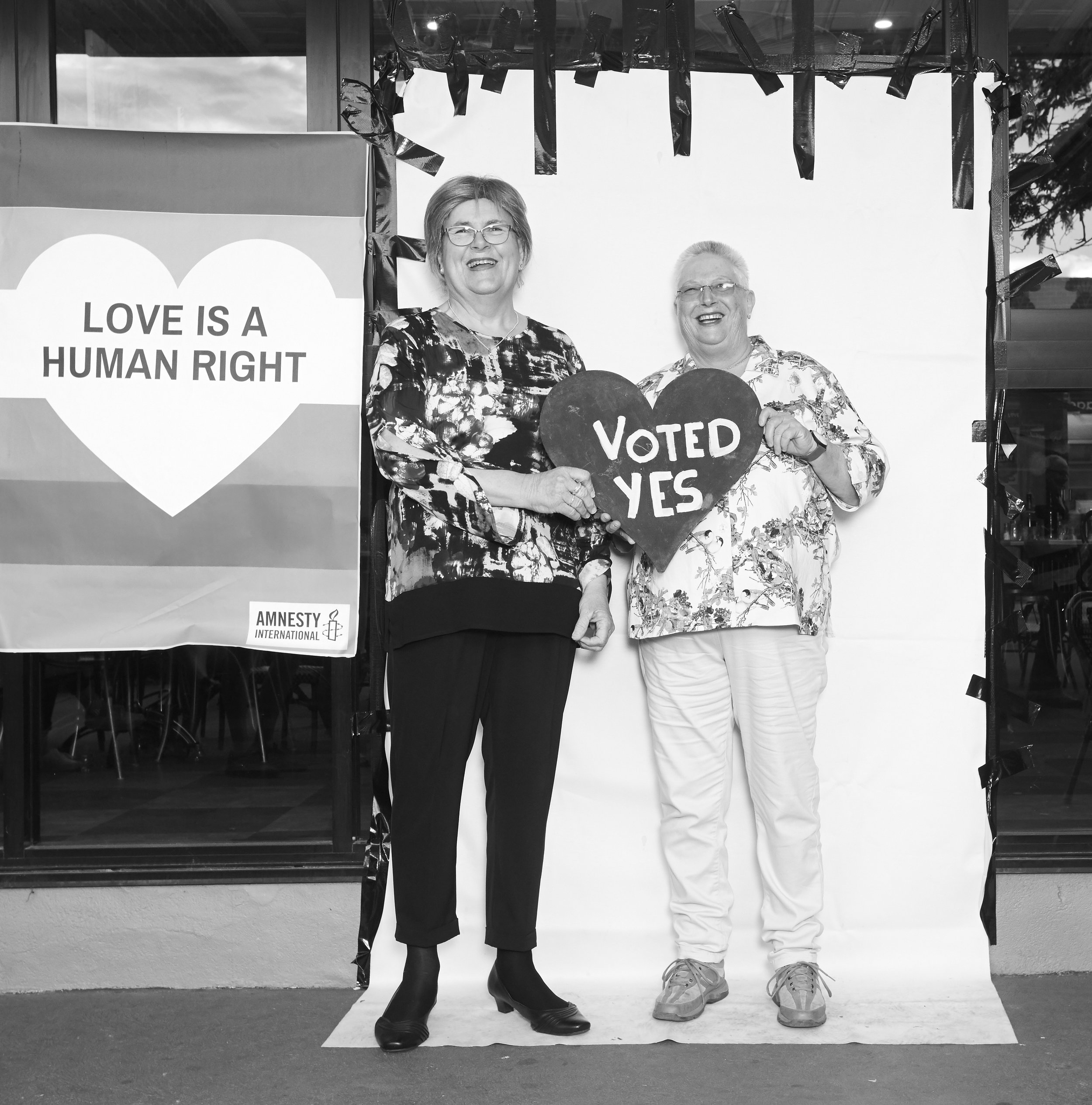 iDo Support Marriage Equality in Gippsland - 2 years ago I had a simple idea, photograph anyone in Gippsland who believe in the equal rights for ALL PEOPLE to marry the person they loved. Since then we have photographed over a 1000 Gippslanders. Raised over $5k, published a book, started a LGBQITA+ Youth Support group, A queer social club, a fund a pop up/in information center to run an amazing campaign over the 3 months of postal voting in the main street of my home town of Sale. All leading the day Australia Vote YES. Our country town community has seen the worse Australia has to offer, from the face of the national no campaign living in Sale, a victim of a hate crime and a news paper who couldn't keep it clean or balanced. We persisted not out of spite but LOVE! Thank you all who stood up to be counted 2, 10,20,50 years ago thank you to everyone who vote THANK YOU TO EVERYONE WHO FOUGHT FOR LOVE AND WON!