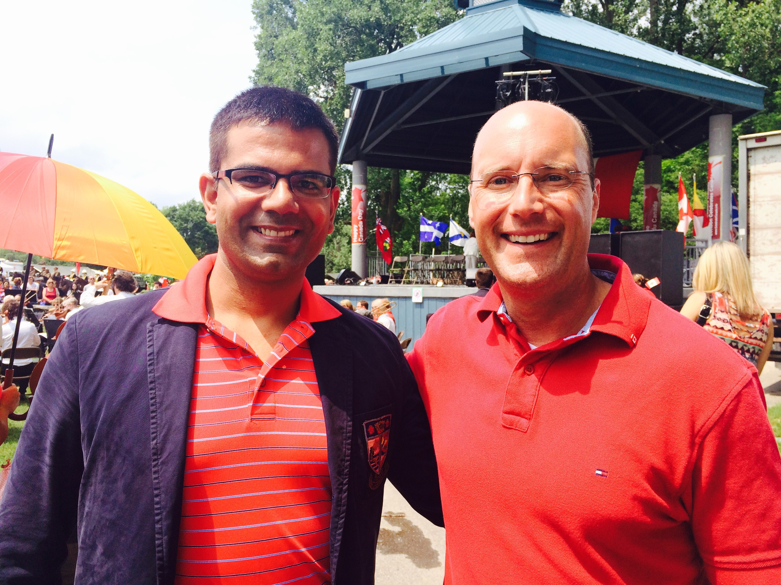 Serving as a social convenor for my clients helps them to embrace their new community and thrive in their professional and personal lives. Anshul Ruhil, Head of Research and Development, COE  at a local software company (left) and City of London Mayor Matt Brown (right), enjoy Canada Day celebrations at Harris Park this past summer.