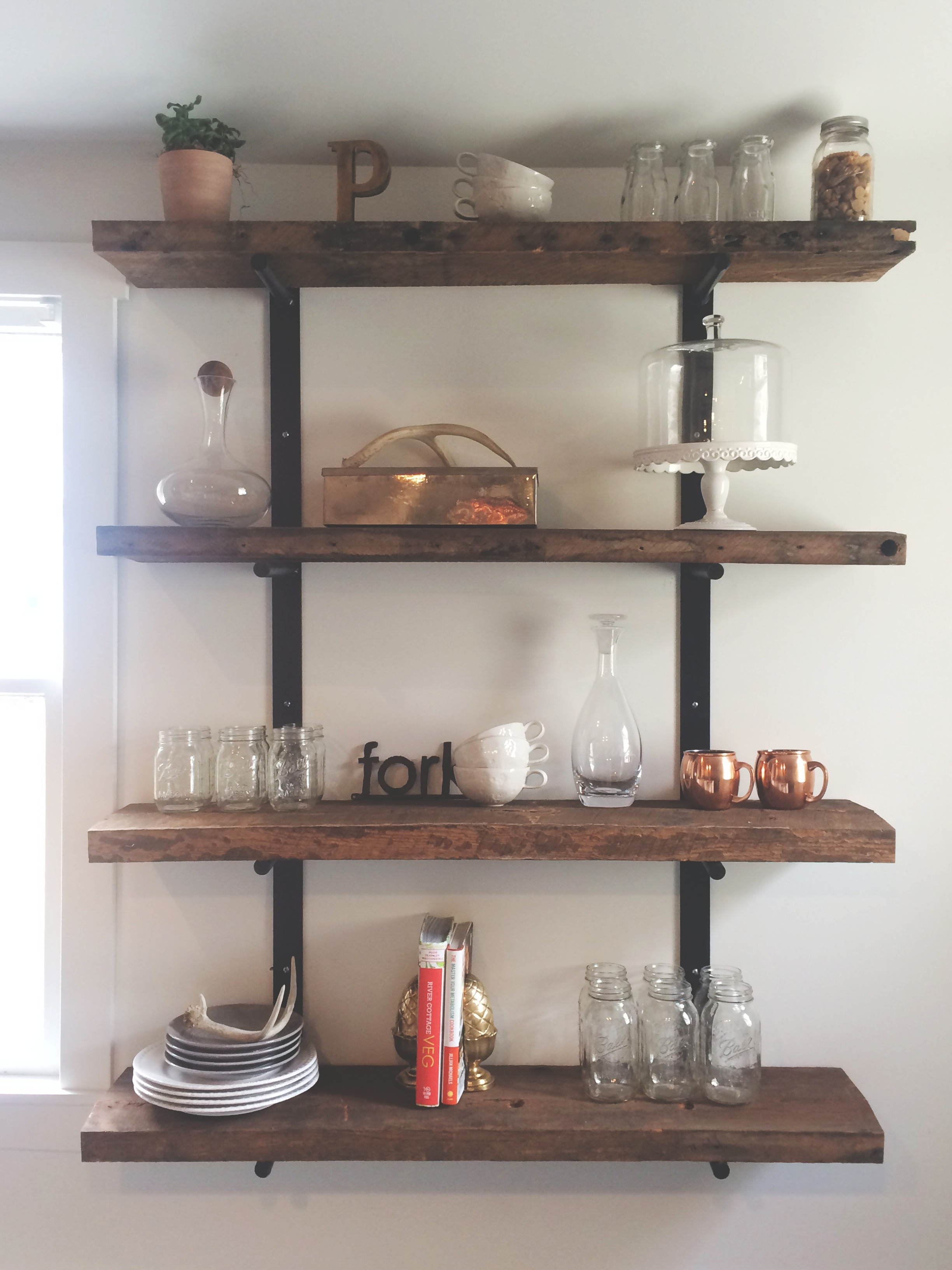 Phil and I designed and built these shelves for our old house. They are the perfect addition in our new kitchen! We received so many wonderful wedding gifts but ran out of room for storage-- these saved us and also make for fun decor.