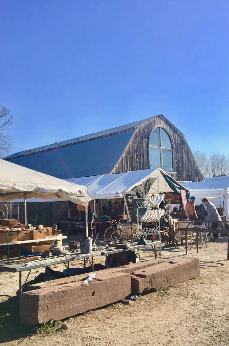 "To Brimfield attendees, this barn is as significant as the golden arches of McDonalds. It means ""you have arrived- get your walking shoes on & take a look around."" Just looking at pictures of this barn makes me giddy."