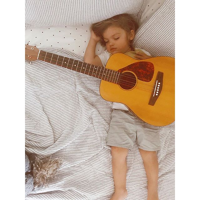 this sweet soul missed his guitar so much while we were up north - it hasn't left his hands since we've been home 🖤 #FWPoll #littlemusician