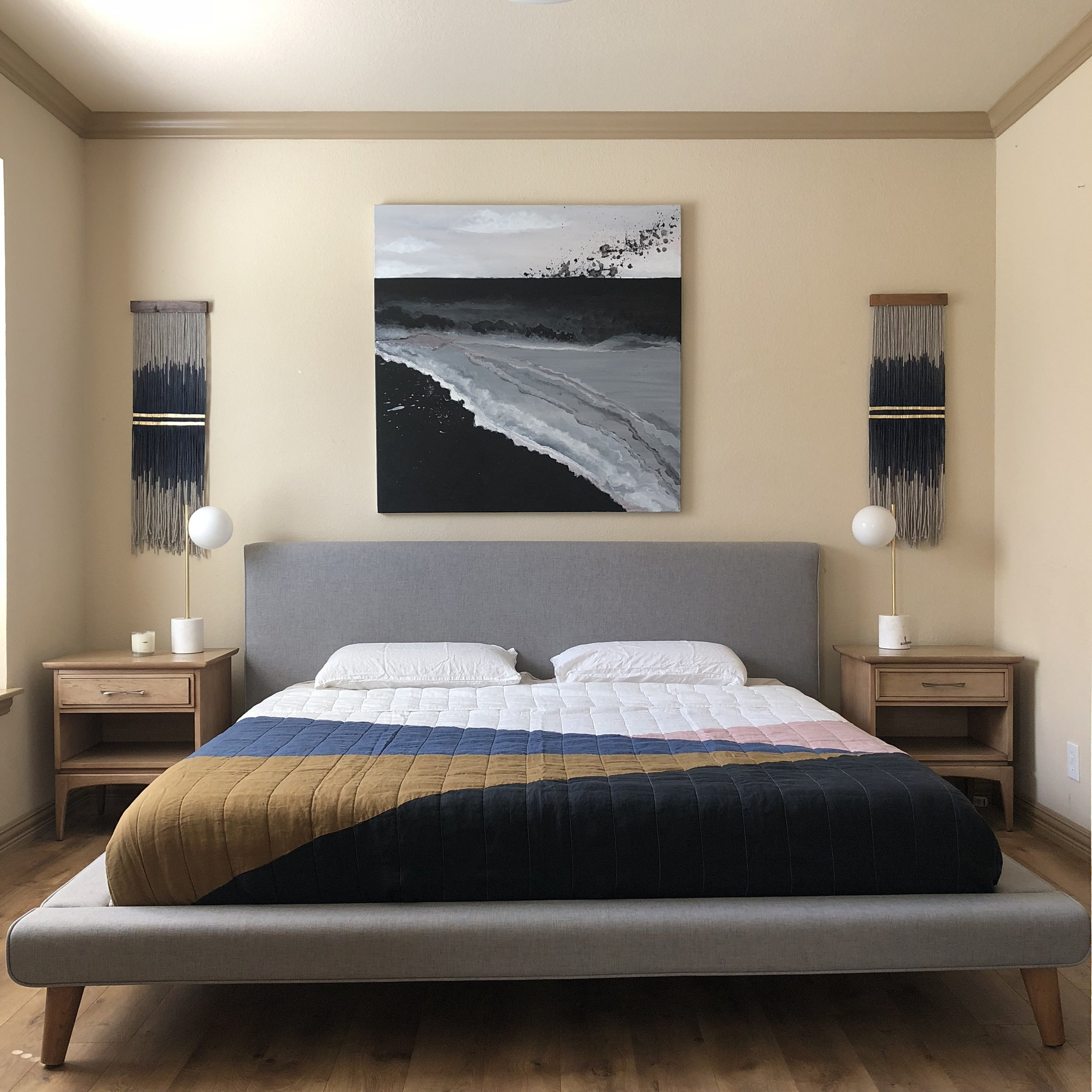 "A pair of ""Revolution"" Mini Tapestries positioned over vintage nightstands by Kent Coffey from @theceh. Painting by Lauren Williams, above modern platform bed by West Elm. Tapestry-inspired bedding by Parachute + Lauren Williams, available online: https://www.laurenwilliamsart.com/store"