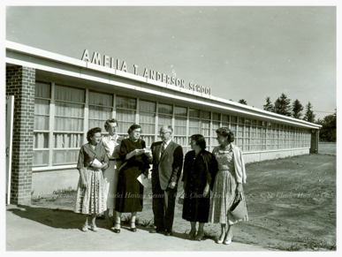 The newly built Anderson Elementary School, George Thompson and Amelia Anderson are in the center of the photograph.