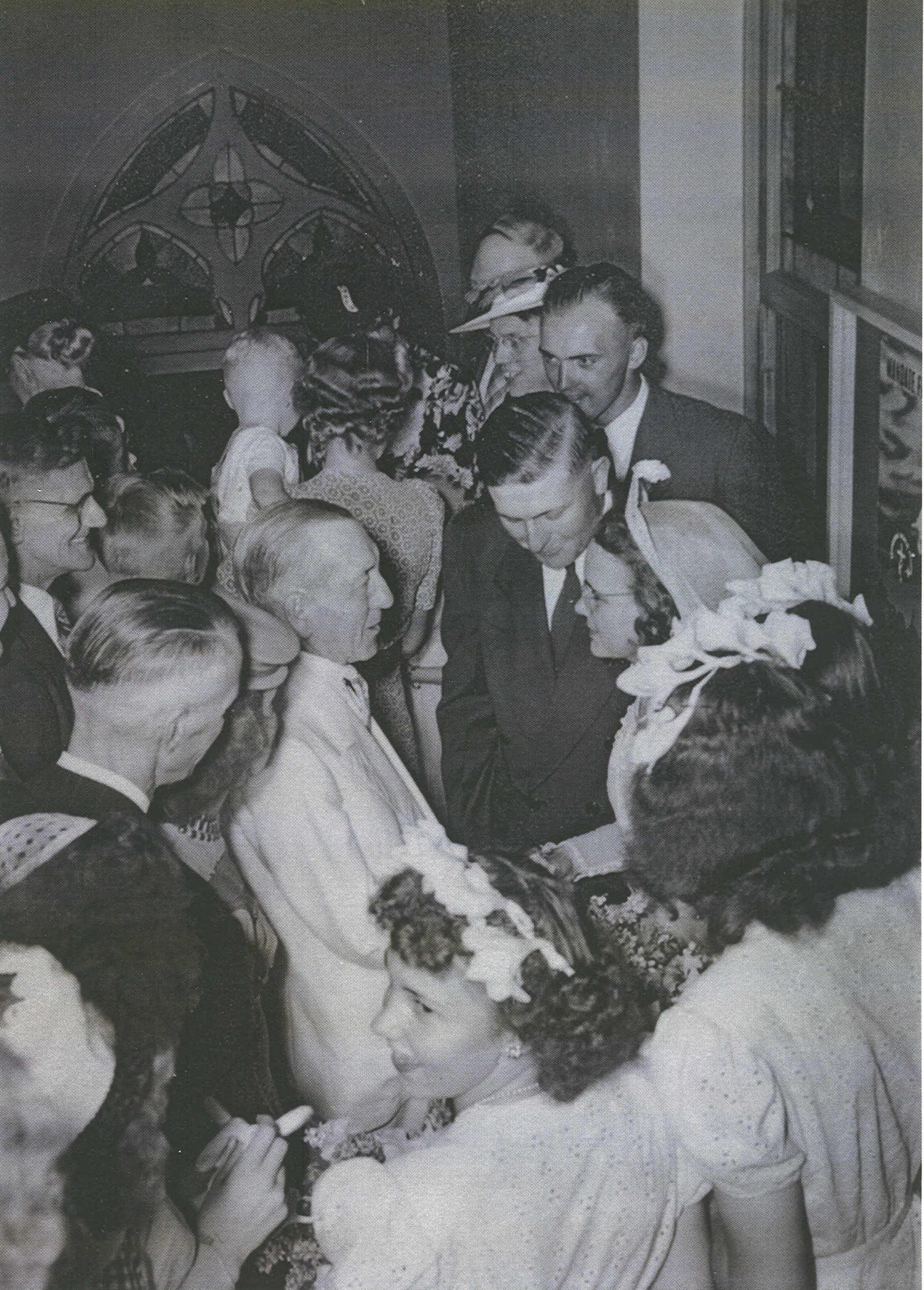 Melvin &Ruth Peterson's wedding, Mr. Baker congratulating the newlyweds.