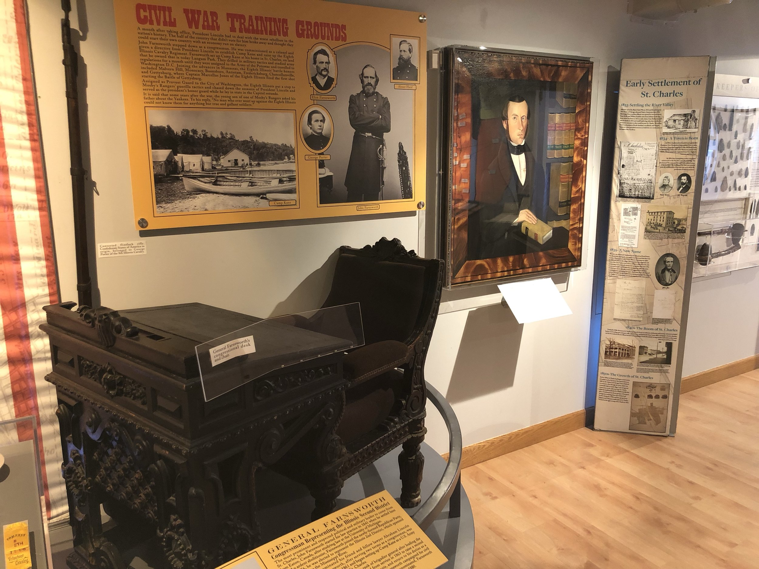 Two artifacts that serve as St. Charles connection to the Civil War and freedom seeking movement of the mid-1800s: the congressional desk of U.S. Representative John Farnsworth and the portrait of S.S. Jones painted by Sheldon Peck.