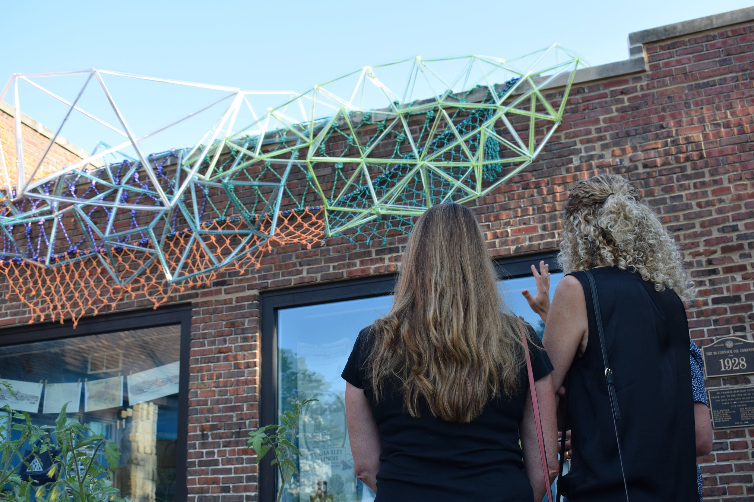 Visitors view  Synapses 4: Community  at the ArtsFest Opening Reception at the Museum on September 5