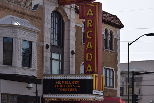 The marquee of the Arcada has encouraged residents and visitors to stay strong and pitch in together during COVID. TK
