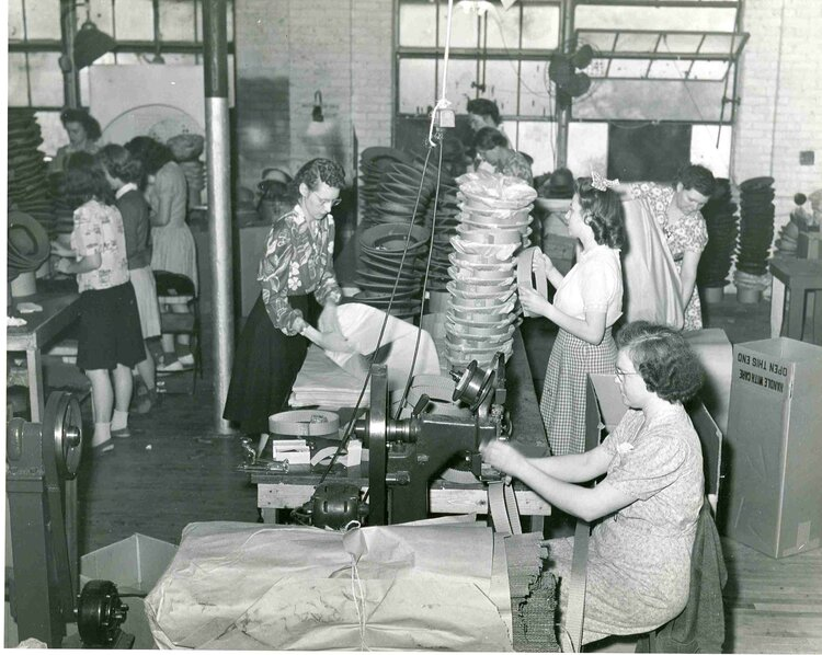 Women assembling pith helmets at St. Charles' Newcombe-Hawley plant off of 6th street, c. 1943. 20,000 helmets a day were manufactured there during World War II, meriting it as one of St. Charles' largest contributors to the war effort, along with Howell Manufacturing. SCHM Archives