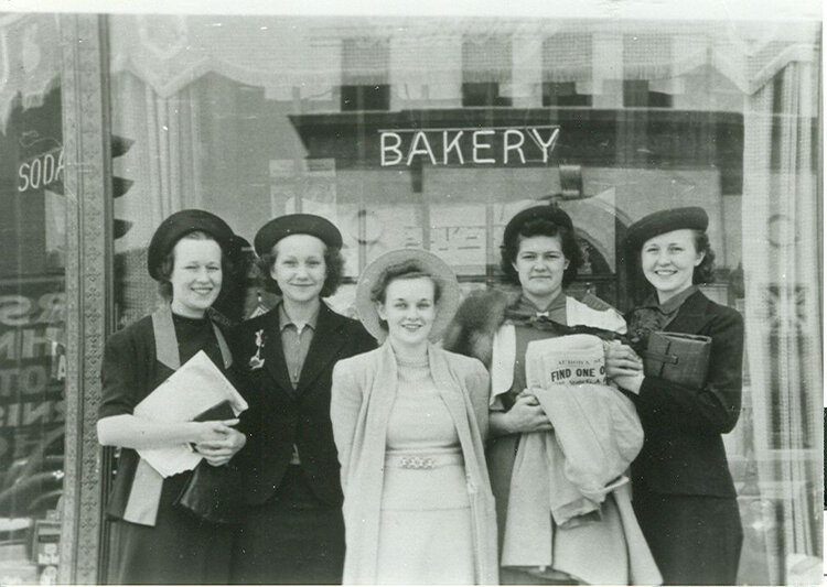 Customers outside of Gartner's Bakery (Kettley Realtors building - corner of Main and Rt. 31), c. 1945. Small business stepped up to support St. Charles in WWII, and are doing so again as we battle COVID-19 together. SCHM Archives