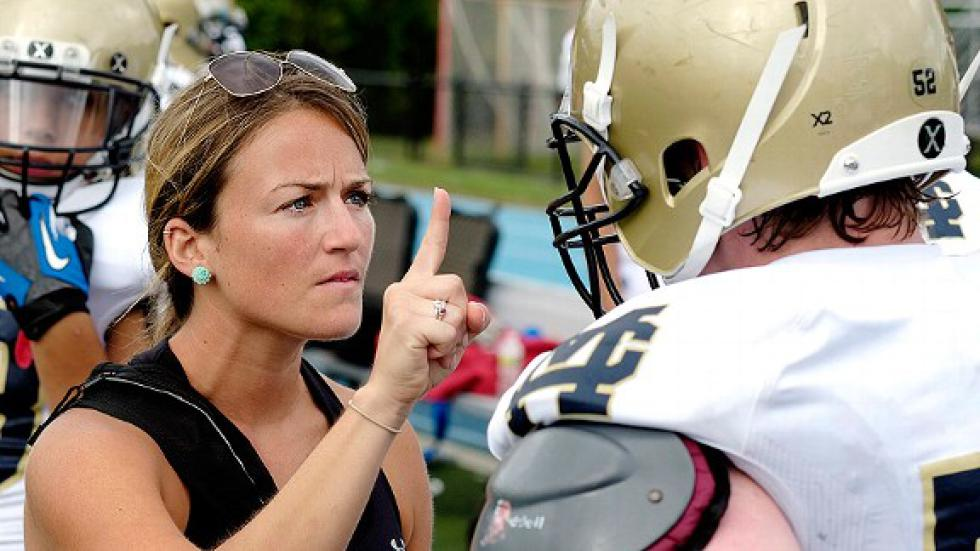Athletic Trainer checking for concussion
