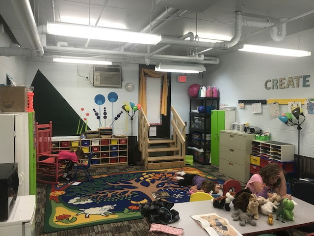 This working space demonstrates that a variety of  seating arrangements helps students to be motivated, focused, and grow their art skills.