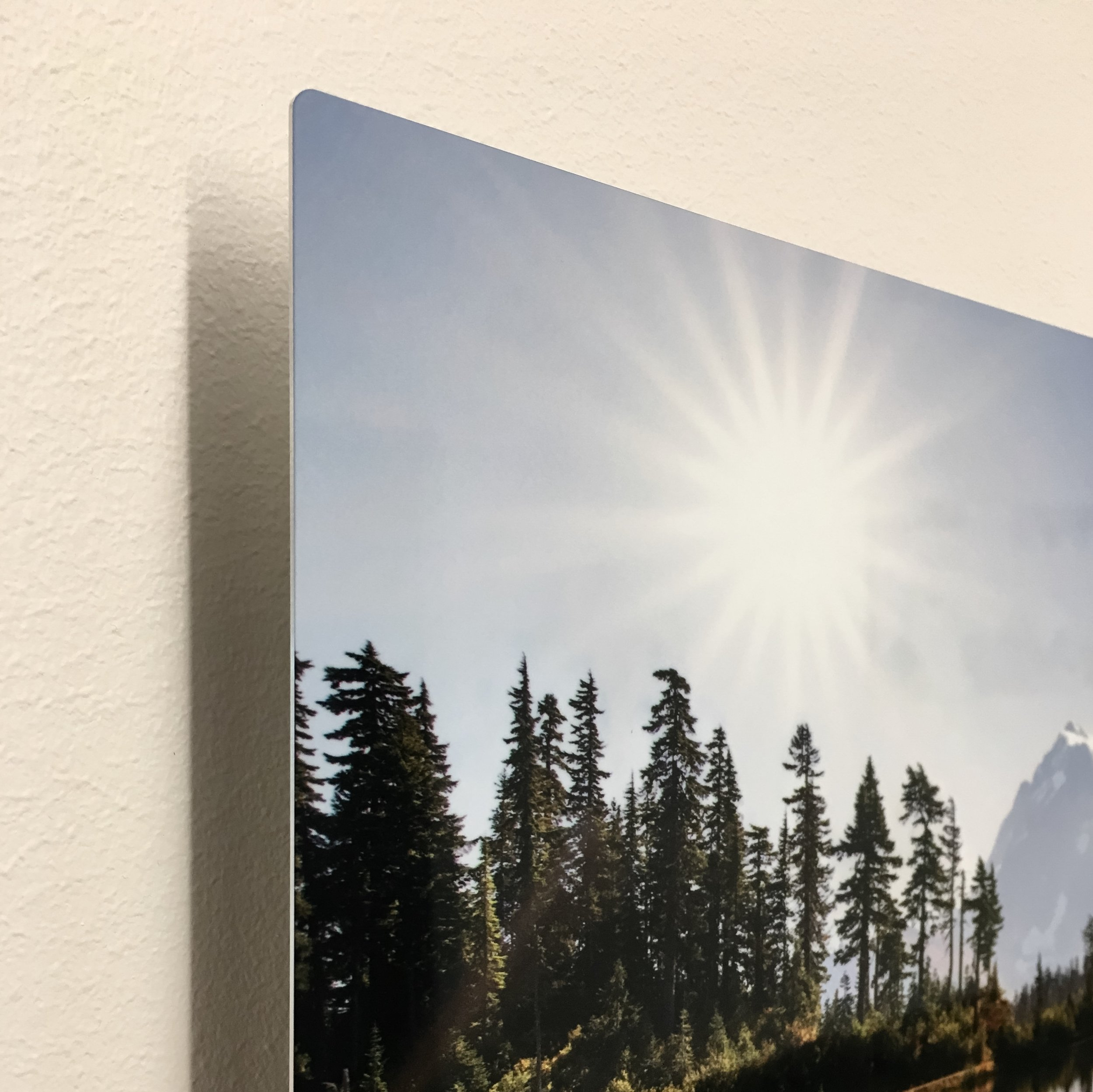 "Sunrise over Mount Shuksan is a 12x18 metal print. A custom hand crafted floating mount with wire hanger will make the image appear to float 3/4"" off the wall when hung."