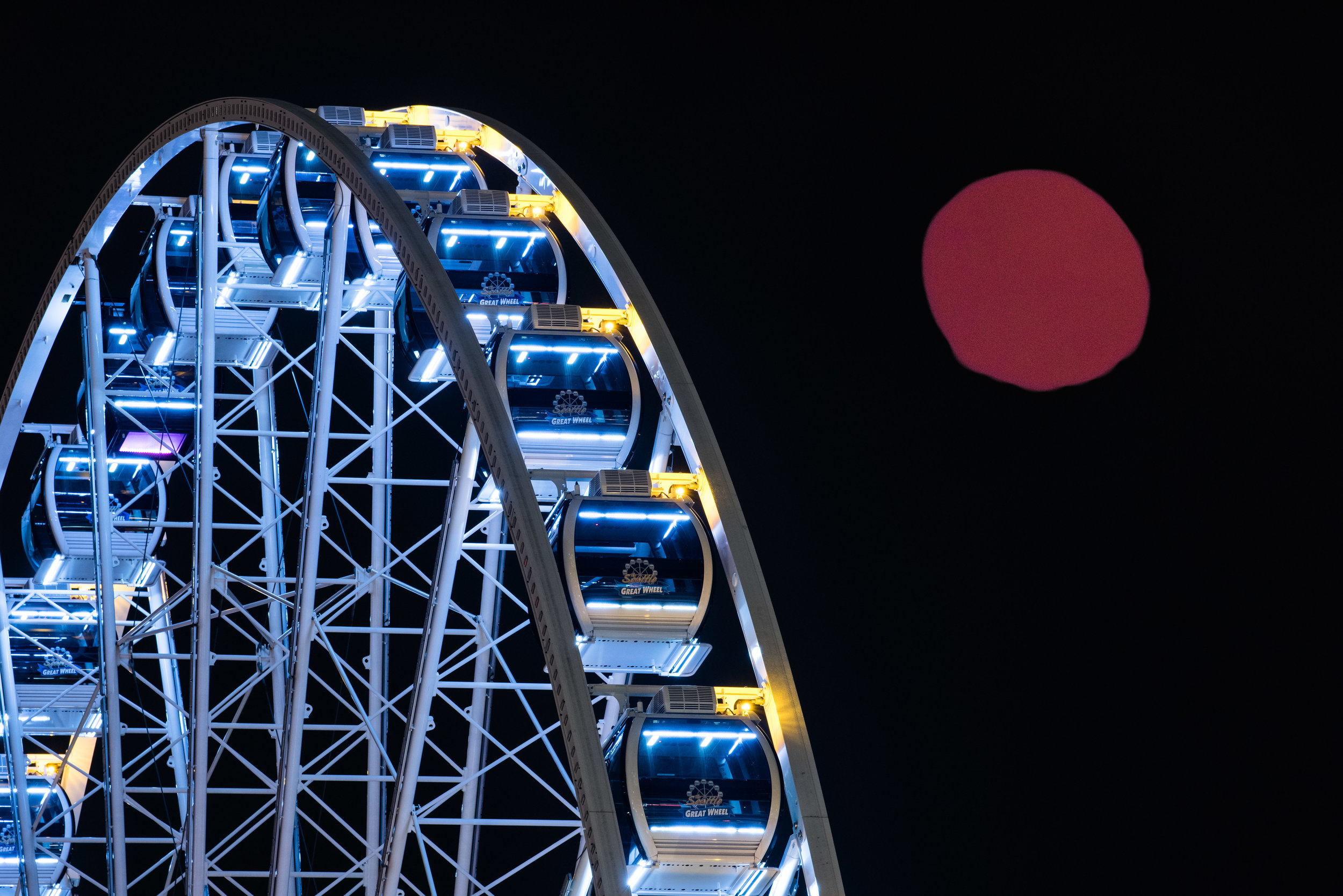 The January 31, 2018 Super Blood Moon rising over the Seattle Wheel via an advanced simulation using Microsoft Paint. Don't do what I did and keep an eye on that cloud cover in the iCSC app.