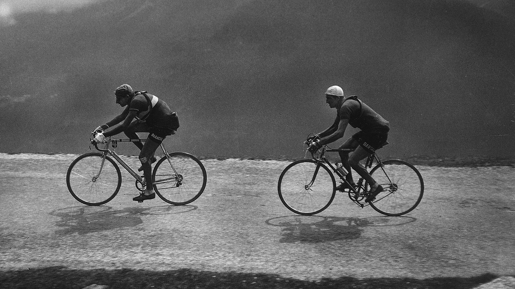 Two very different riding positions from the days before the addition of scientific enquiry into bike fitting. Fausto Coppi and Gino Bartali. Did Coppi used to have neck ache?!