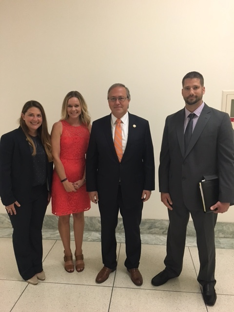 Member Emily Reichard with Allison Malmstrom (NATM), Rep. David Young and Jake Morrison (H&H Trailers)