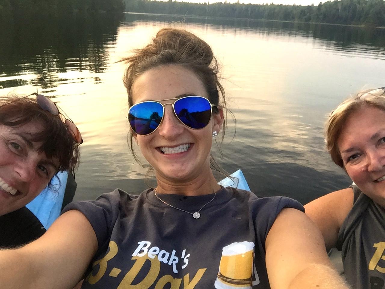 Jalene, Lauren, and Rhonda kayaking in Michigan.