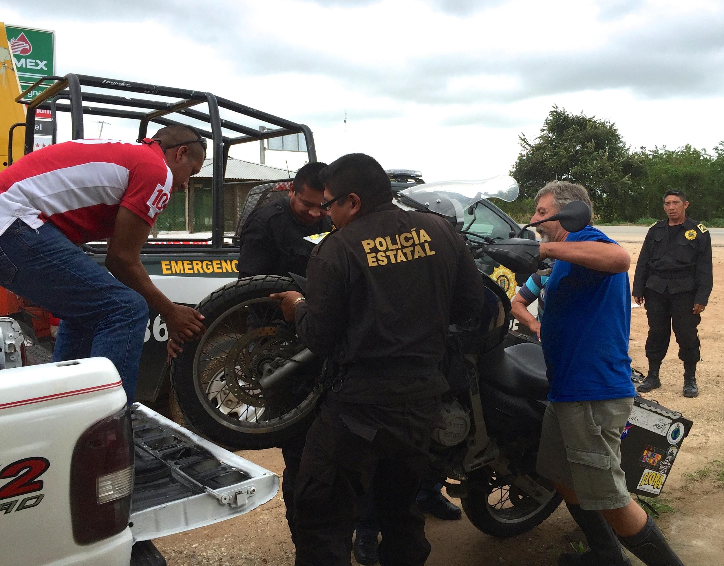 Jalene's broken down bike being loaded in a truck...