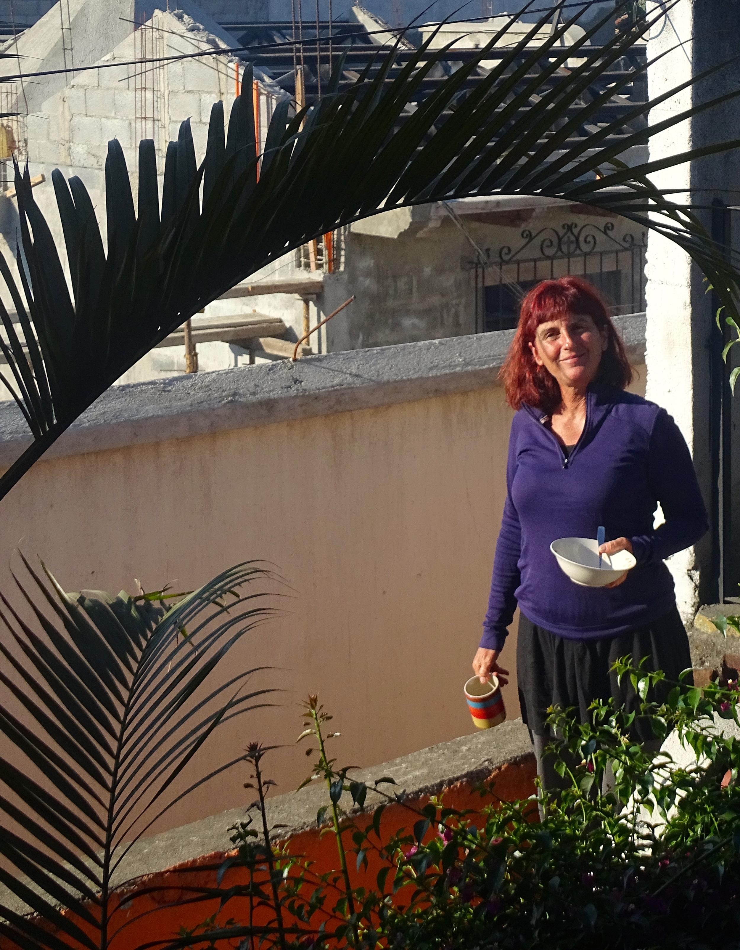 Jalene finishing breakfast outside our room.