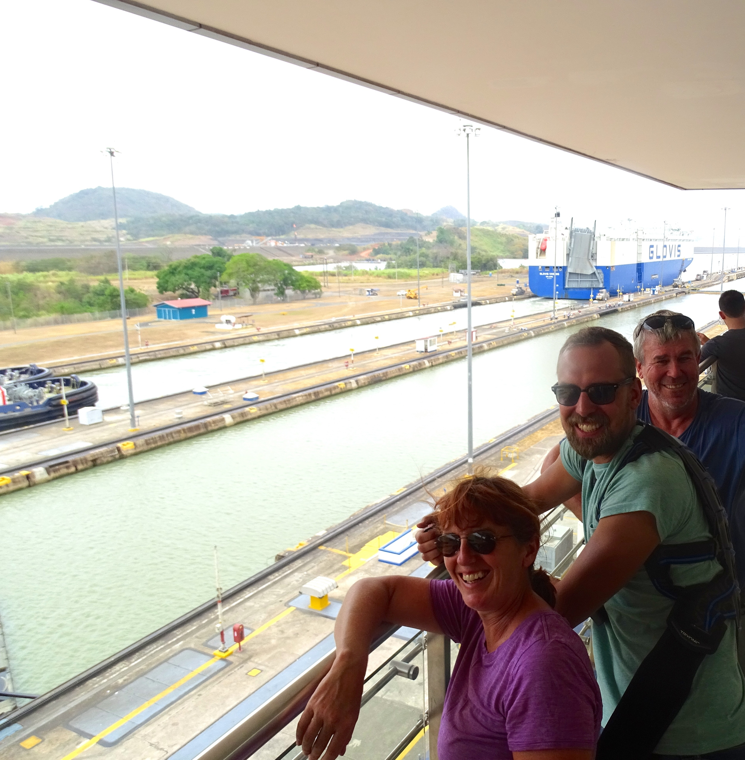 Jalene, Ondrej, and Peter in awe at the Panama Canal Locks.