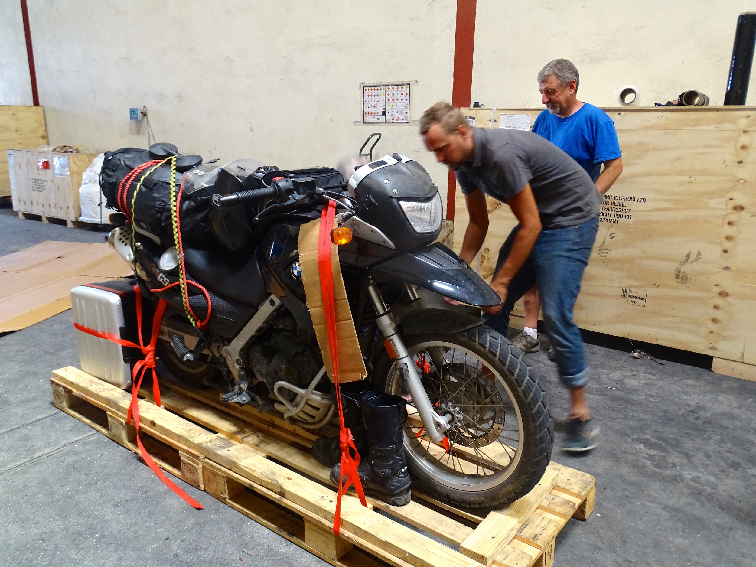 Ondrej had everything neatly arranged on the pallet around the bike.
