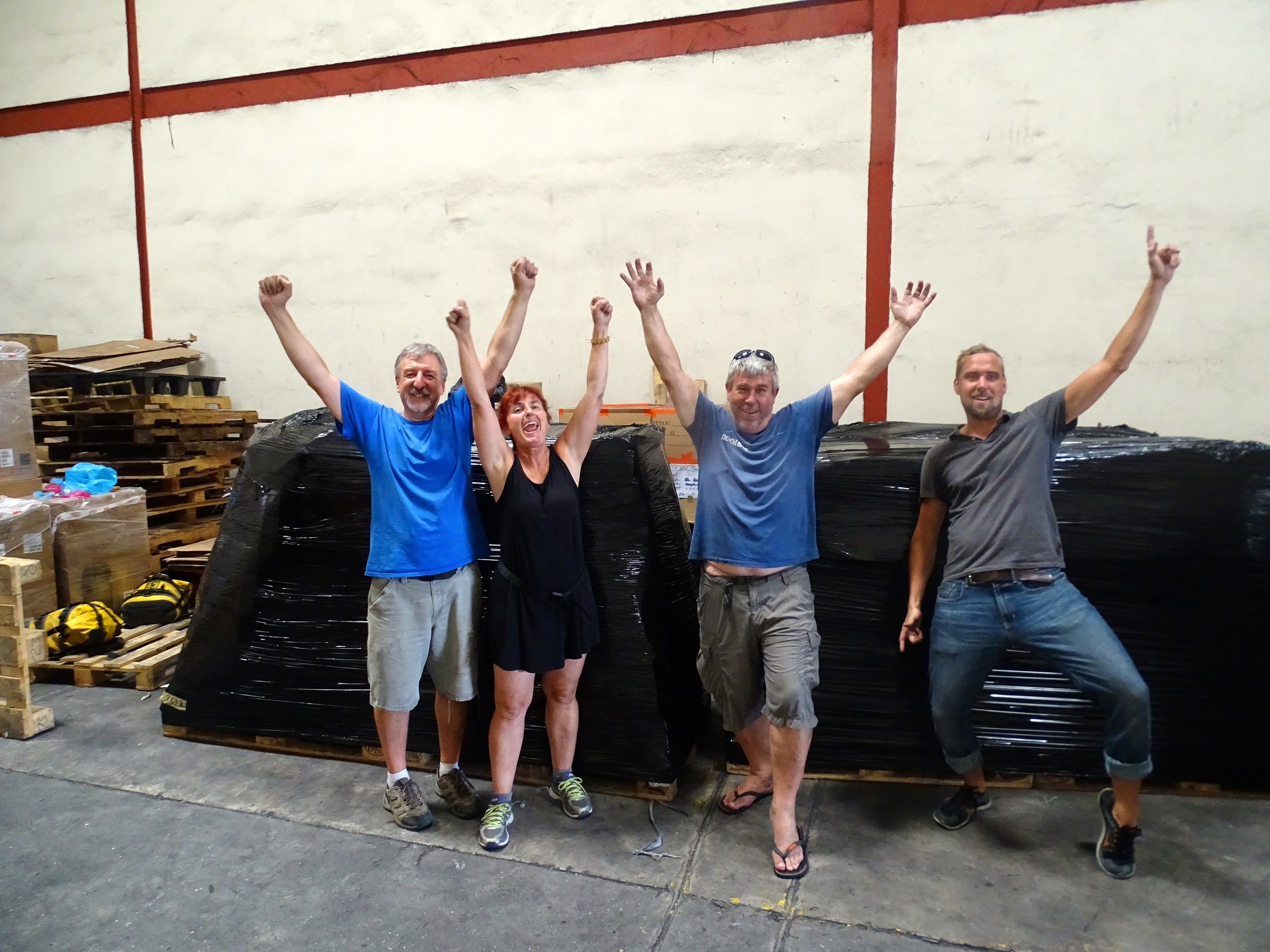 """Triumphant in front of our four """"packages""""!"""
