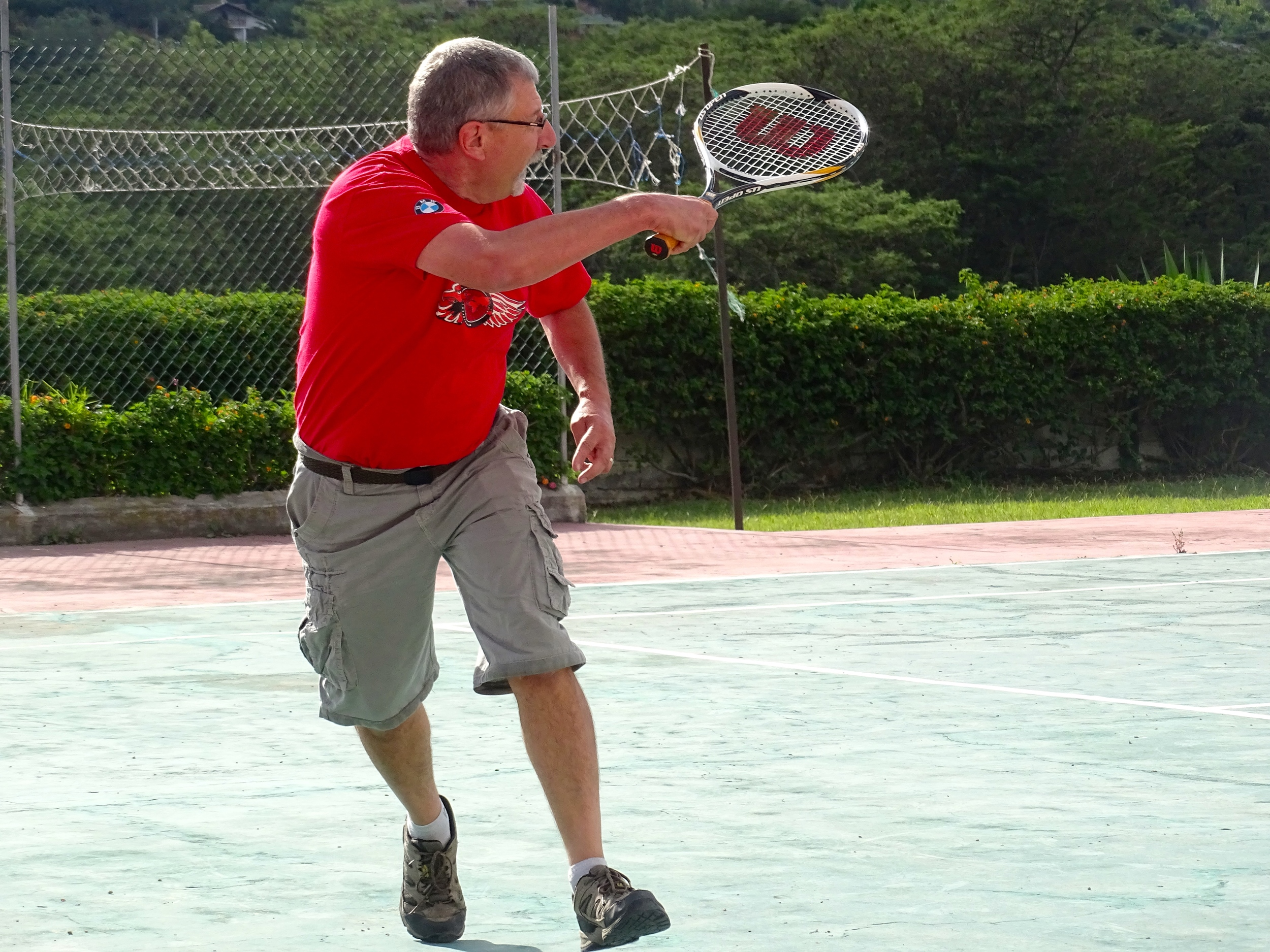 We got to play tennis. This is Keith in action! He did great.