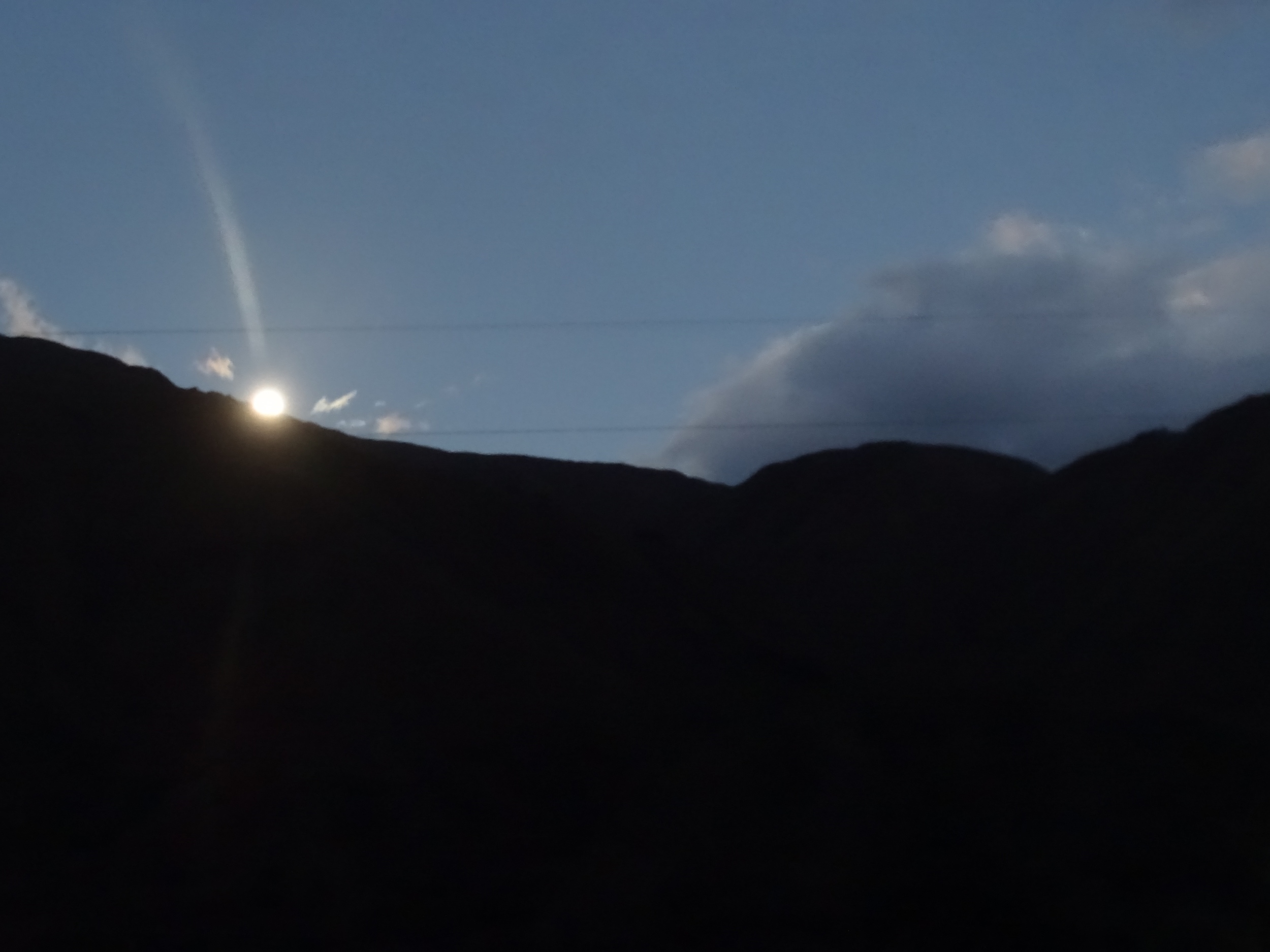 As I was waking up, the full moon was disappearing.