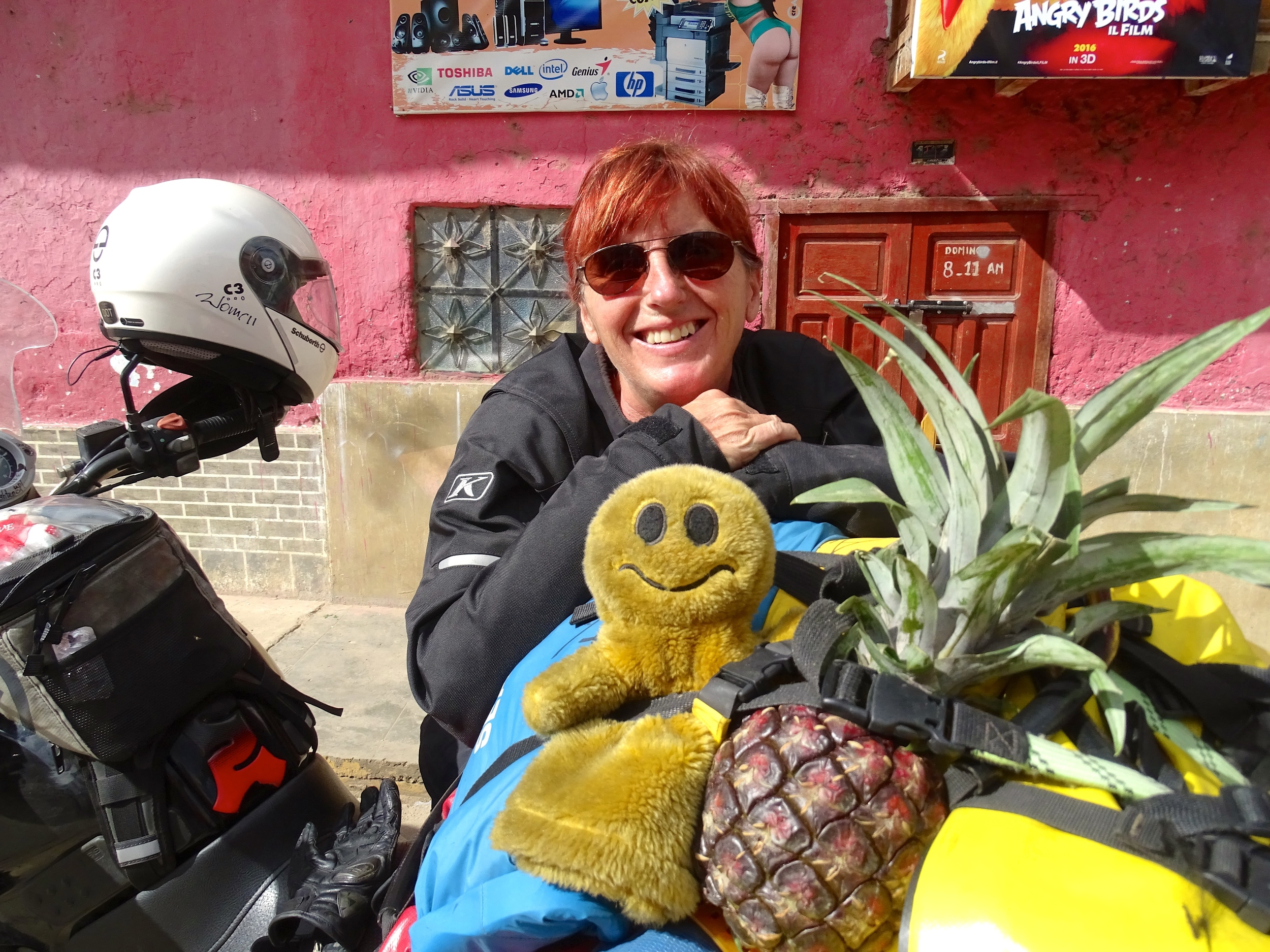 While Keith was chatting, I was shopping for fruits & veggies in the market. This pineapple had to ride on top with Senior Feliz.
