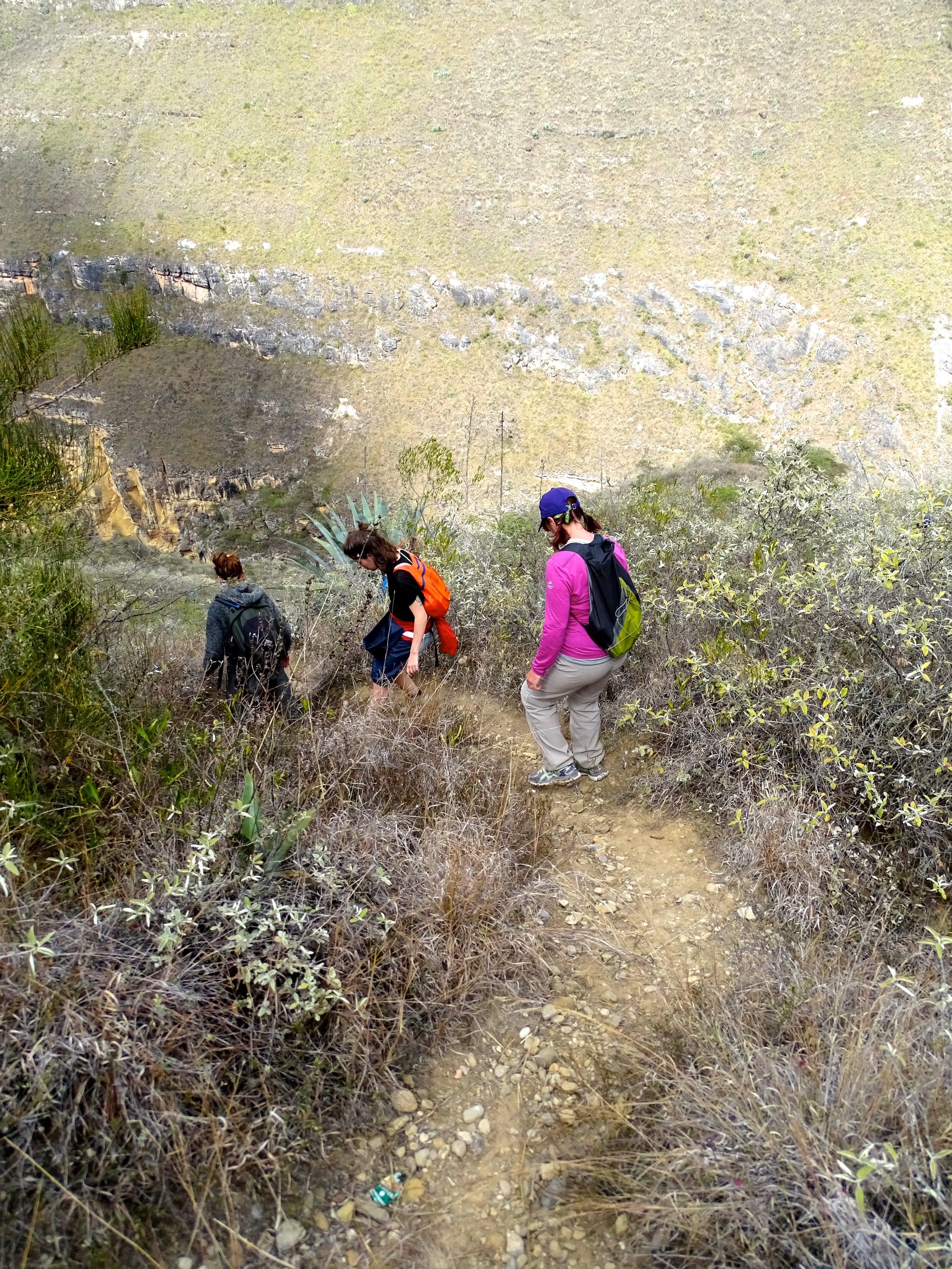 """After Karajia, we hiked down into the steep slot canyon to see the """"Wanglic"""" ruins far, far below."""