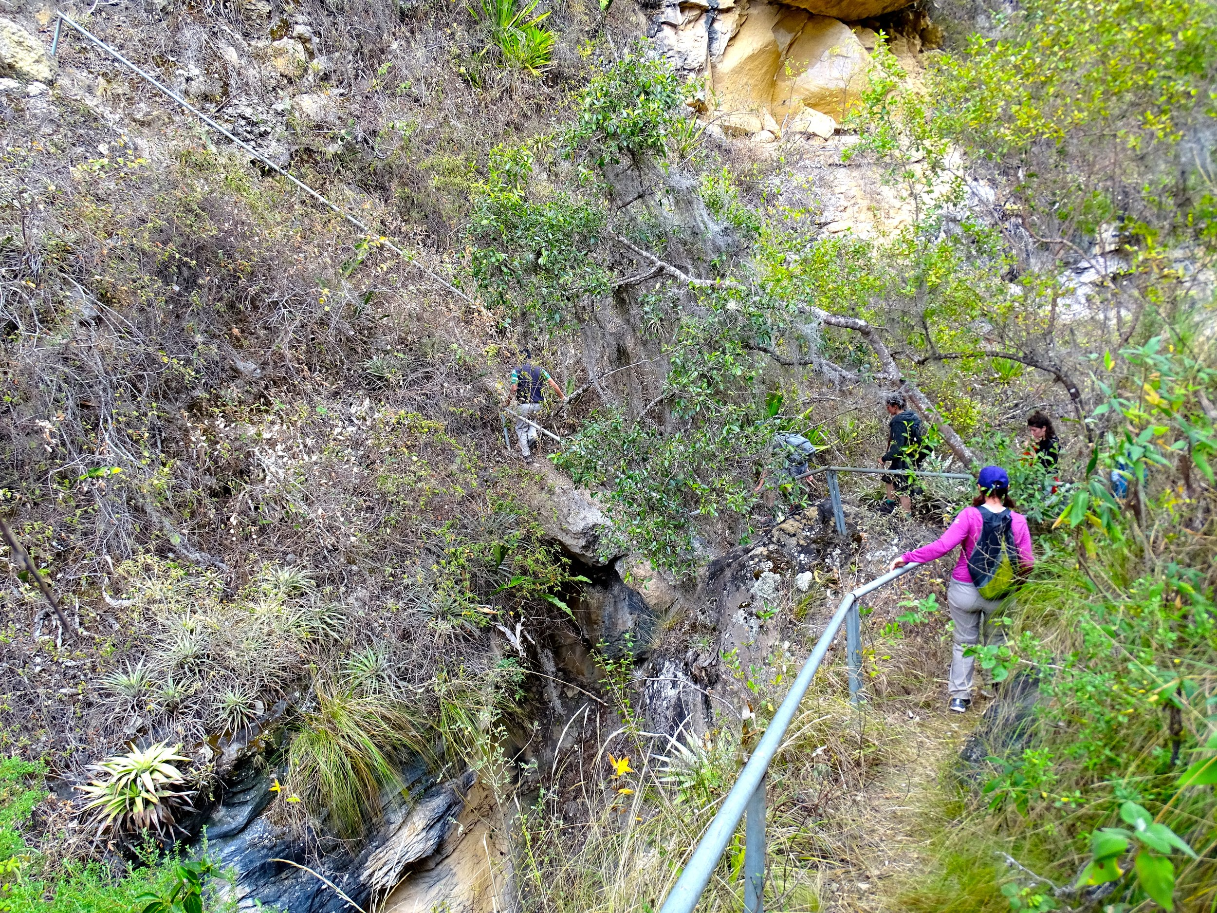 It's difficult to tell, but ahead of Jalene are two big boulders that have wedged between the narrow canyon walls, forming a bridge that we crossed to reach the ruins.  It was the only way in and out.