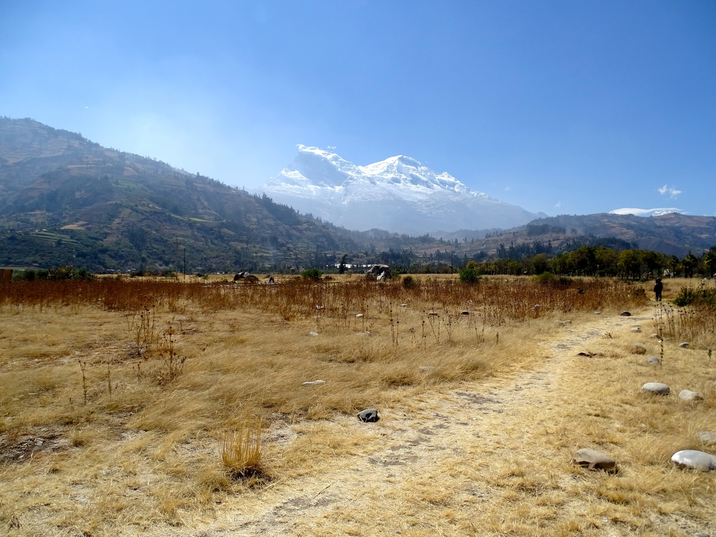 The buried ruins of Yungay, Peru. On May 31, 1970, Nevado Huascaràn in the background, Peru's highest peak, let loose an ice and rock debris flow from the near-vertical west face shown here.